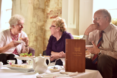 3 elderly people enjoying Afternoon Tea at the Priory House Tea Rooms in Dunstable