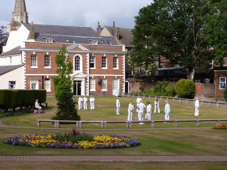 A game of Croquet being played in Priory Gardens