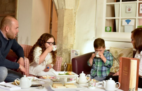 A family having afternoon tea in the Priory House Tea Rooms