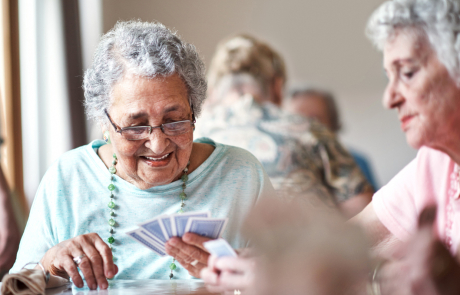 Older People playing a game of cards