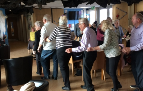 A conga line breaks out at the Creasey Park Lunch Club