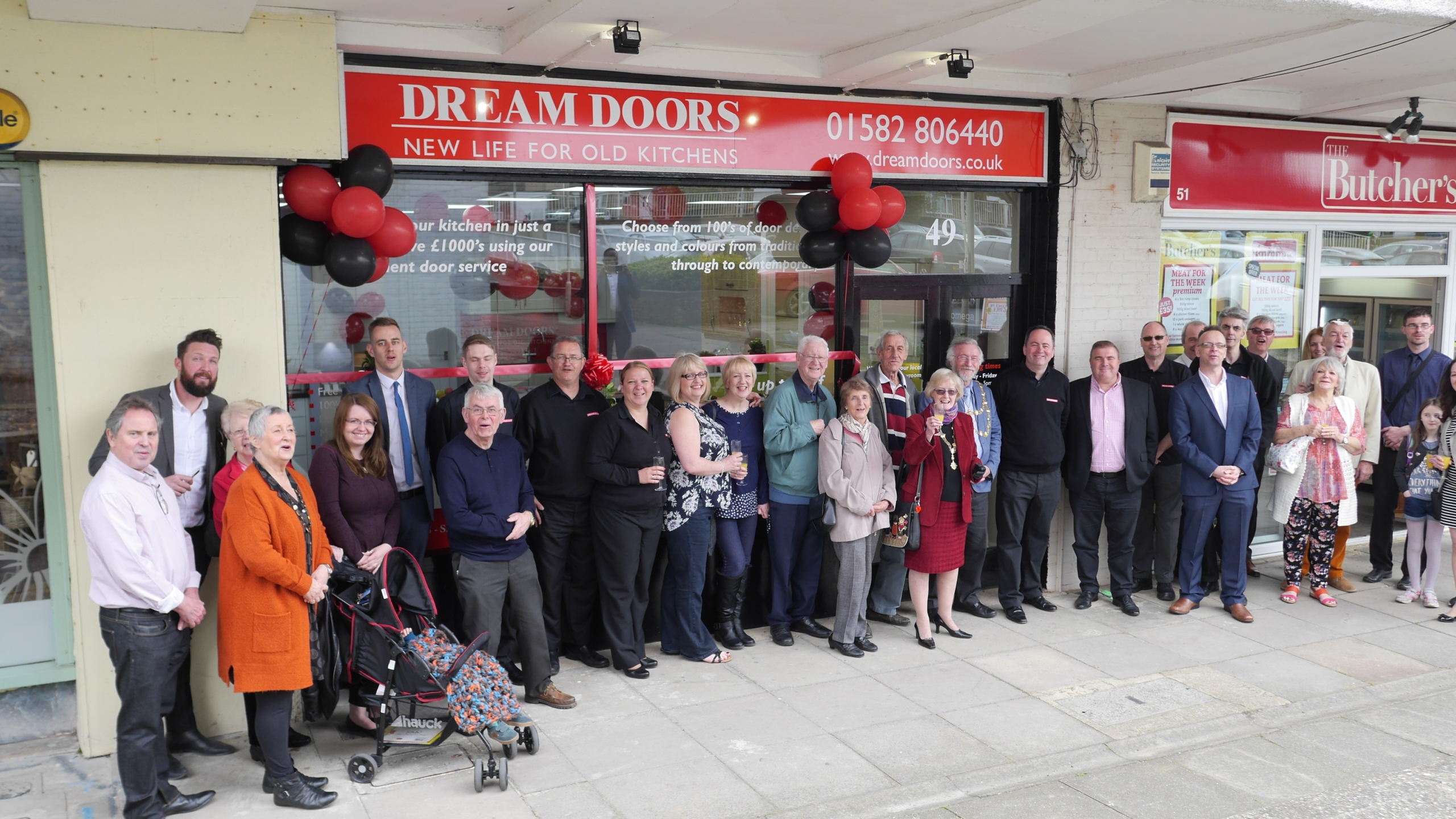 Dunstable Mayor and members of the public outside dream Doors in Dunstable